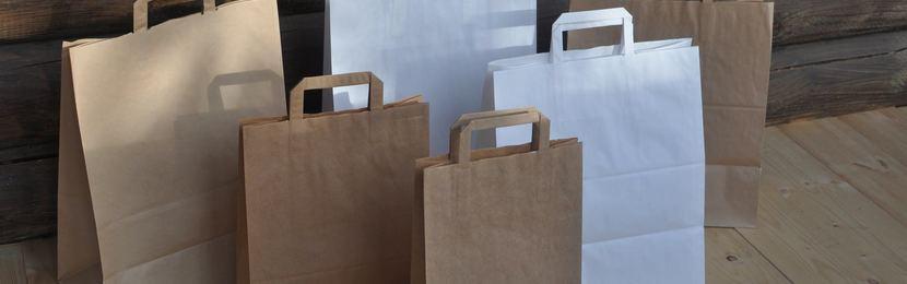 упаковка из крафта,коричневые крафт пакеты,крафт пакеты с плоскими ручками,нанесение на крафт пакеты,печать логотипа на крафт пакетах,крафт пакеты с логотипом,шелкография на крафт пакетах